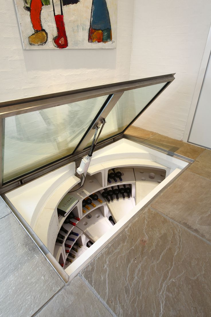 White Spiral Cellar with rectangular glass trapdoor.