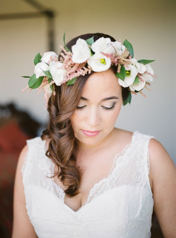 An elegant curled hairstyles with a complimentary floral crown is a great pairing for a vineyard wedding.