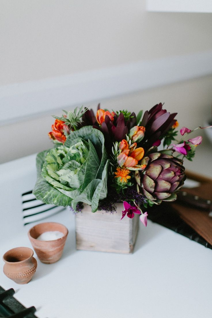 """""""Veggie Garden"""" of rich colors of purple, orange, red and greens with seasonal ornamental kale, artichoke, and leucodendron. Artistically designed by BloomNation's Beet & Yarrow from Denver, CO."""