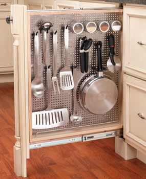 In a small kitchen with little storage space, you can make even narrow filler spaces work harder by installing a vertical pegboard rollout.