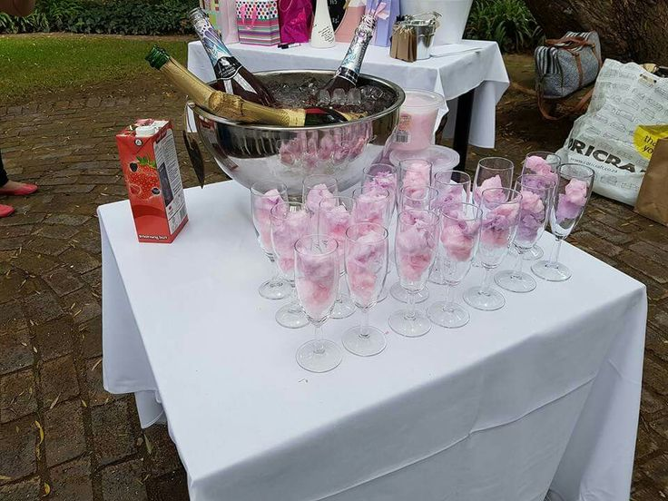 Cotton candy balls in champagne flutes