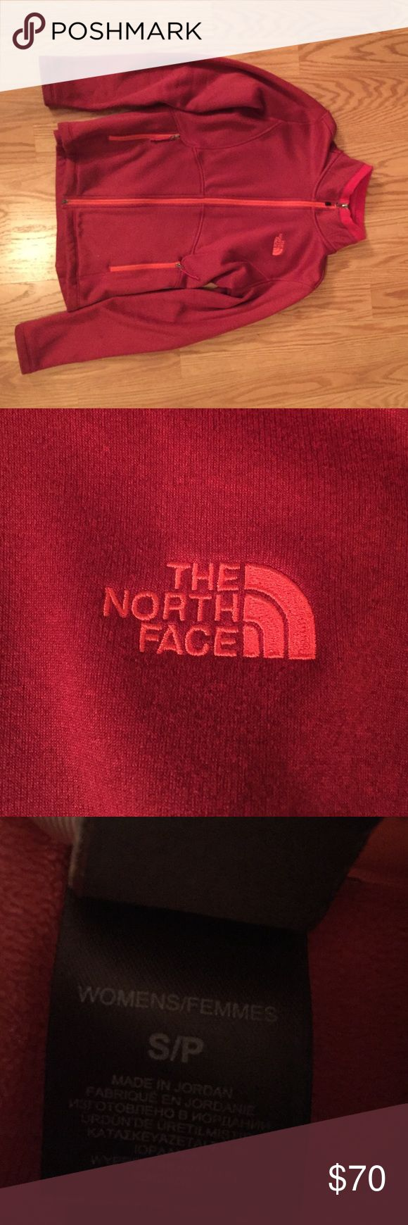 A northface jacket A red north face jacket with a pink logo, has slight wearing on the end of the sleeve. North Face Jackets & Coats