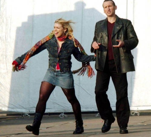 One of the most accurate pictures of Nine and Rose that I've ever seen.  Obviously, he's trying to explain something important and complicated, and she sees something off in the distance that she's excited about.  She grabs at his hand, but he's too busy using them in his explanation, so she gets a handful of his jacket instead and drags him along behind her, not paying any attention at all.  He continues his discussion and doesn't notice for five whole minutes that she hasn't been…
