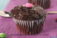 Choco Cups: Chocolate muffins topped with chocolate icing and edible gems.