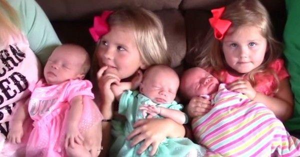 La pareja posa con sus trillizos recién nacidos. Entonces la mamá ve algo en sus caras que deja a todos en shock.