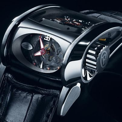 """Parmigiani Bugatti Type 372 """"Super Sport"""". Designed to look like a transversal engine, and is mounted in 18 carat gold."""