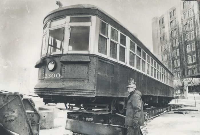Railroaded into history. On its way to a museum; this 1921 Peter Witt-type streetcar is inched off the flatbed of a transport truck on to tracks at Queen's Quay. The car will be restored and put in Canadian Railroad Museum at Harborfront. One of first cars ordered when Toronto Transportation Commission took over from Toronto Railway Co. in 1921; it was taken out of service about 1961; and had been in Canadian Railroad Historical Association's Montreal museum.