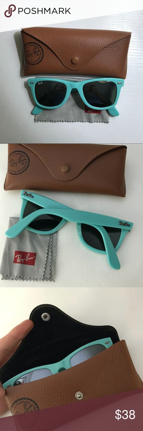 Orginal Ray-Ban Wayfarer sunglasses Orginal Ray-Ban Wayfarer sunglasses. Style RB2140 962 with polarized lens. Amazing condition, lightly worn.   Light blue, turquoise color frame.  Comes with original case & duster. Ray-Ban Accessories Sunglasses