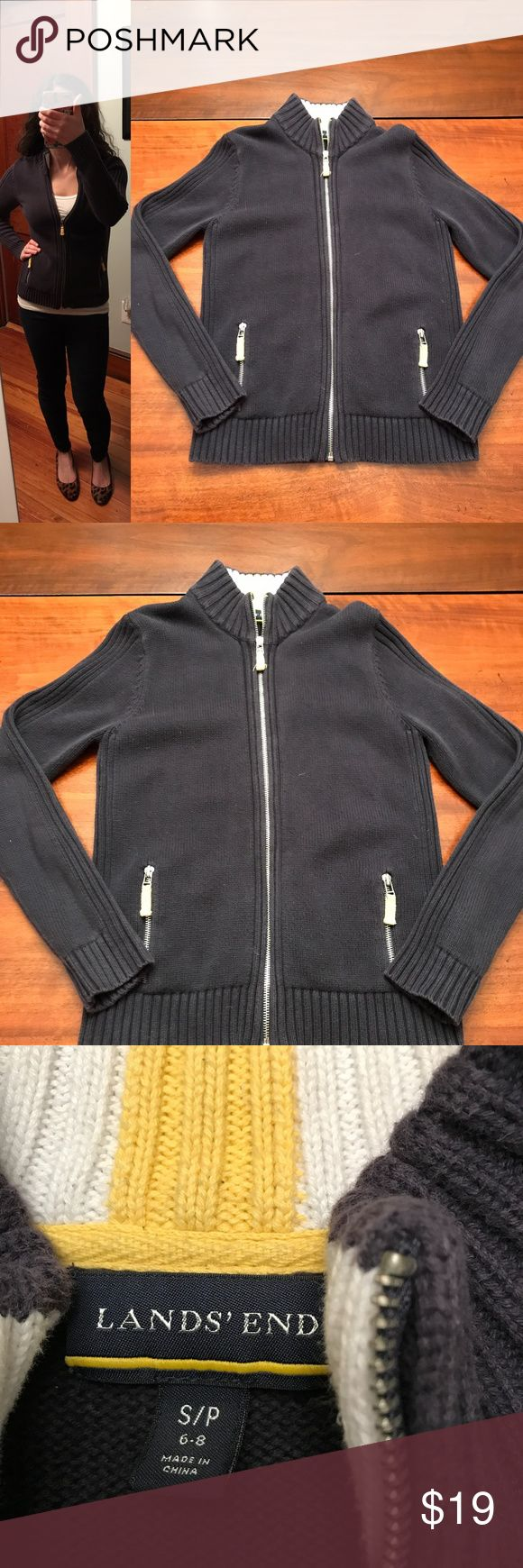 """Land's End Navy Zip Up Cardigan Land's End Navy Zip Up Cardigan, size petite medium. Sweater is in good pre-loved condition, but shows some signs of wear (some pilling/fuzzing throughout). Approx. measurements when laid flat: 17.5"""" pit to pit, 23"""" shoulder to hem, 23"""" sleeve. 100% cotton. Machine wash and dry flat. Lands' End Sweaters Cardigans"""