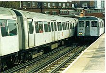 London Underground A60 and A62 stock in their original unpainted livery at Rayners Lane station