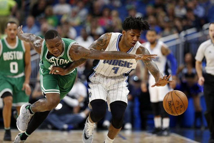 Dec 7, 2016; Orlando, FL, USA; Boston Celtics guard Terry Rozier (12) and Orlando Magic guard Elfrid Payton (4) go after the loose ball during the second half at Amway Center. Boston Celtics defeated the Orlando Magic 117-87.