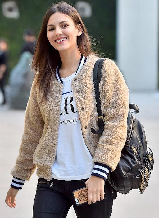 Victoria Justice looked stunning in a ripped skinny jeans, white t-shirt and fleece bomber jacket as she arrived at the Arclight on Sunset Boulevard, Hollywood with her sister Madison to catch a movie on November 27, 2015....