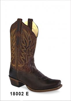 Botas de Senhora Texanas Cowboy Modelo 18002E Marca Old WestBotas em Castanho em pele verdadeira e de excelente qualidade, confortáveis, femininas e práticas.Podendo adaptar-se a todo o tipo de vestuário, ficando muito bem com vestidos, saias, calções e calças.Marca: Old WestRef:18002EEstilo: Botas Cowboy em peleCor: Castanho/Castanho escuroPerímetro do cano: 36 cmAltura tacão: 3,5 cmFabricação: Goodyear WeltedForro: Pele