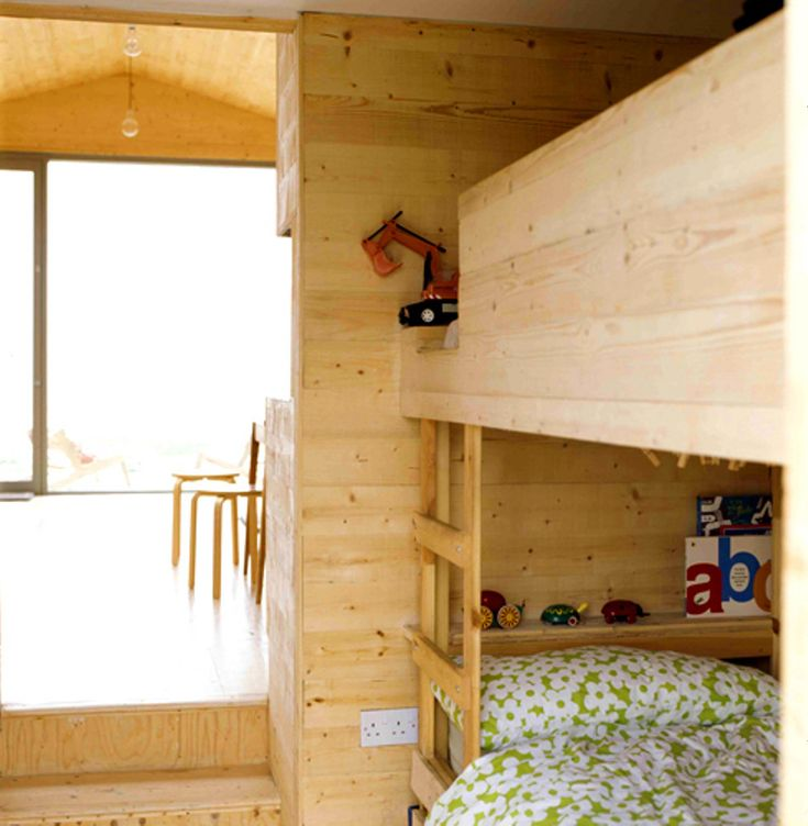 Nina Tolstrup designed this tiny modern beach house for her family just an hour away from London. It sits on a small patch near