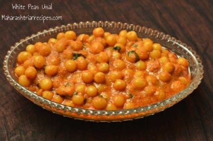 Here's a simple recipe of white vatana usal very much popular in our homes. Read the traditional safed vatana usal recipe here!