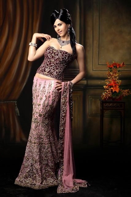 Rose pink french nett lengha with maroon corset with antique zardosi embroidery and delicate crystal elements. An ideal indian bridal dress by AD Singh. Buy it now exclusively online www.adsingh.com Follow us: http://www.twitter.com/adsinghdesigns http://www.facebook.com/adsinghdesigns http://www.youtube.com/adsinghdesigns