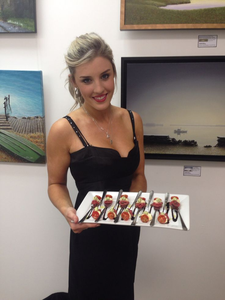 Deluxe Hostess serving canapés at an Art Gallery launch  Www.deluxeevents.co.nz