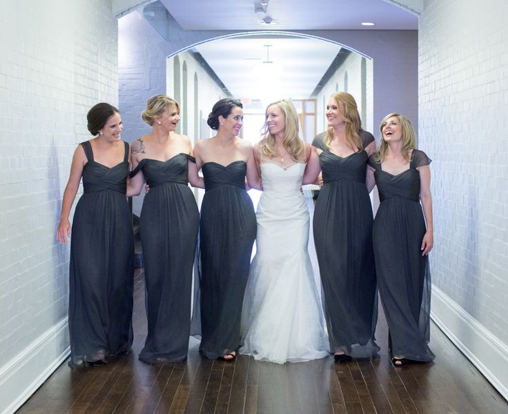 Royal Conservatory of Music hallway, bride walking with her bridesmaids