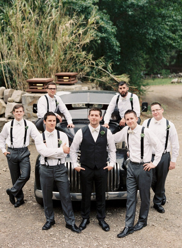 Thinking this is a good set up. He in vest, grooms men in suspenders. Black for him, gray for them.