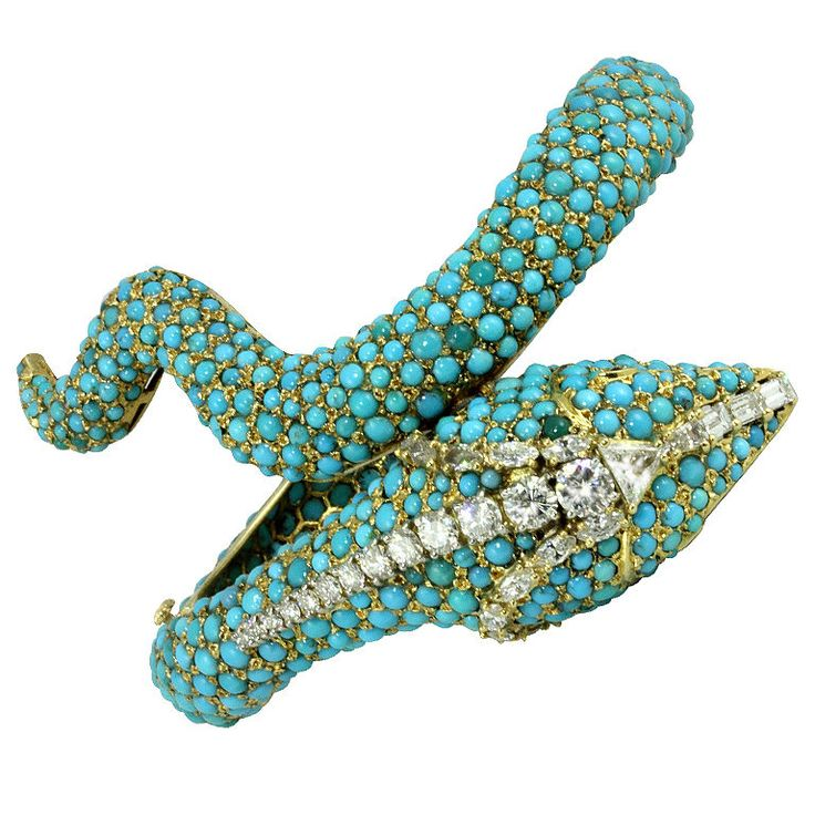 Cabouchon turquoise bangle with round diamonds, marquise diamonds, baguette diamonds, and triangle diamond detail.