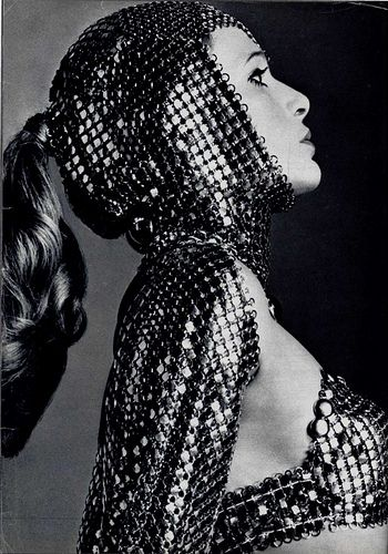 Paco Rabanne- a famous designer of the 1960s who reflected the Space Age Fashion heavily in his designs.  Rabanne made dresses of square pieces of plastic held together with metal rings.