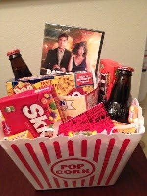 MOVIE HAMPER: dvds, beer, sweets, etc. presented in a popcorn carton