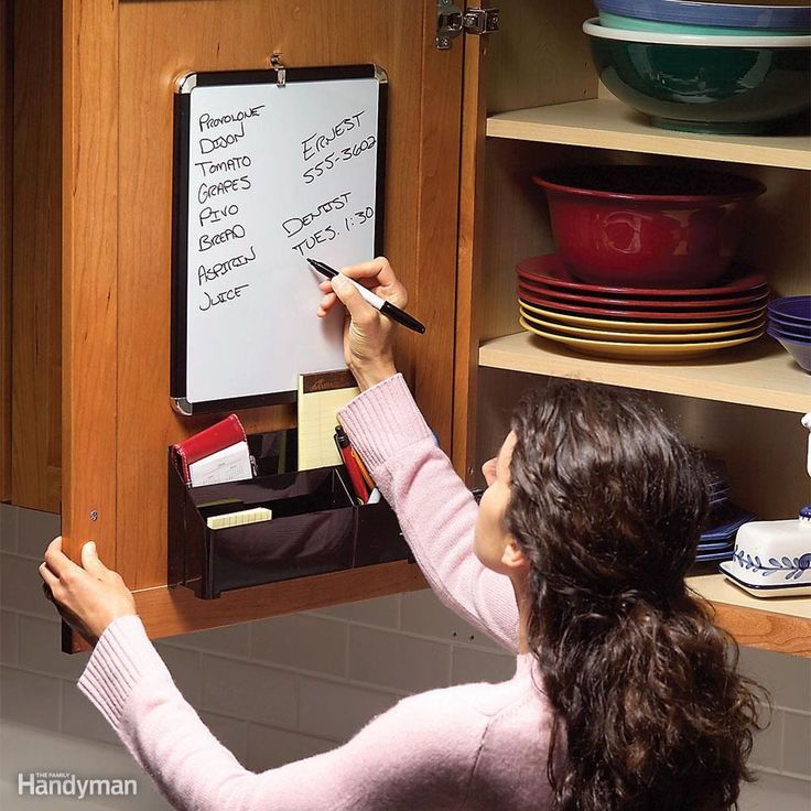 Don't let shopping lists, phone messages and to-do notes clutter up counter space. Mount a dry-erase board and a plastic bin on the inside of a cabinet door with double-sided foam mounting tape. The bin will protrude into the cabinet, so be sure to position it where it won't collide with shelves or the stuff inside. Get the board, bin and tape at a discount or office supply store. #PhoneMessages