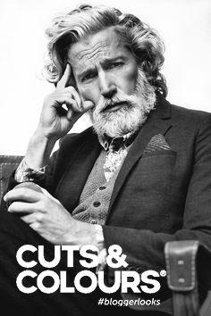 Een modieuze haarstijl voor mannen met een stoere bos krullen en een serieuze middenlengte