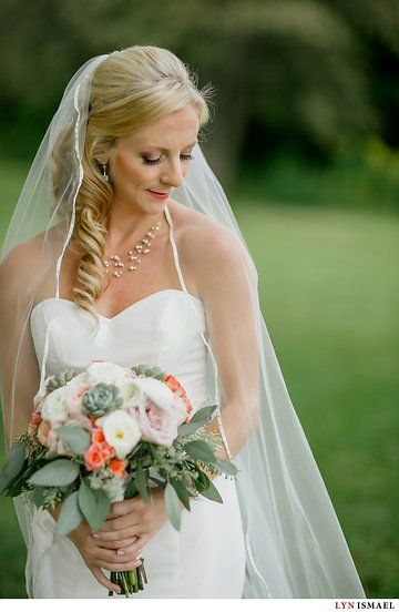 Blonde bride with long veil. Wedding hair ideas. Pearl necklace. Photo from Michelle and Greg collection by Lyn Ismael