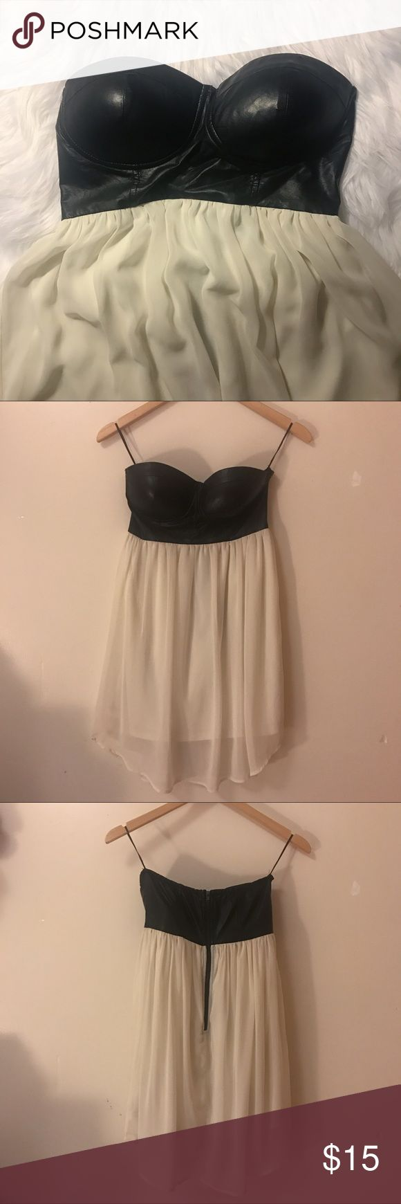 """Foreign Exchange Strapless Dress Foreign Exchange black and off white Strapless Dress. Only worn one time. Has lining inside. Bust: 12.5""""; Length: 26"""" Foreign Exchange Dresses Strapless"""