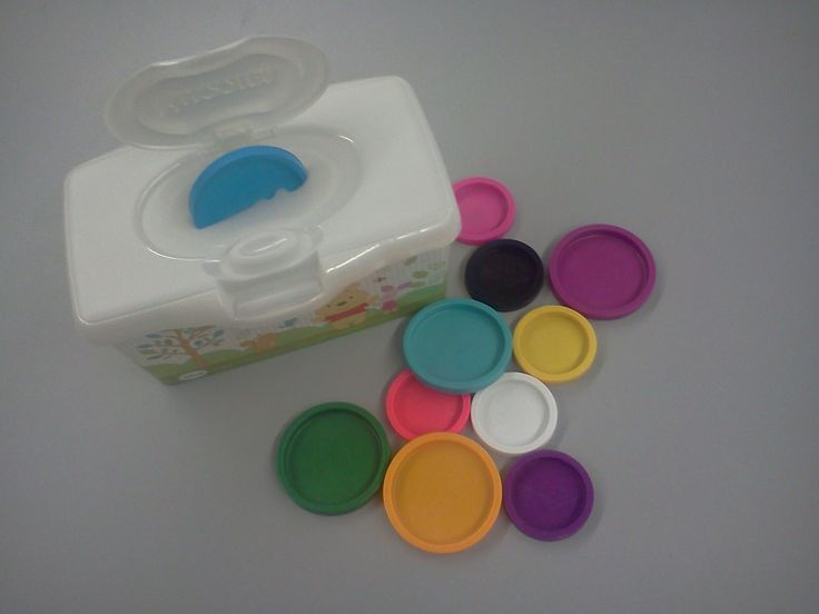 Fine motor: Made today for my preschool classroom w/ empty baby wipes container &  Play-Doh lids-LS