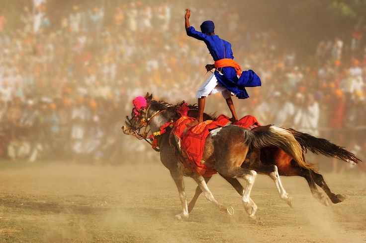 20 Photos That Show How Different Parts Of India Celebrate Holi Holi for the holy city of Anandpur Sahib is more than just colours. It's about a show of physical strength through daring acts like mock-battles, sword-fighting displays and exercising on speeding horses. And nobody does it better than the Nihang Sikhs.