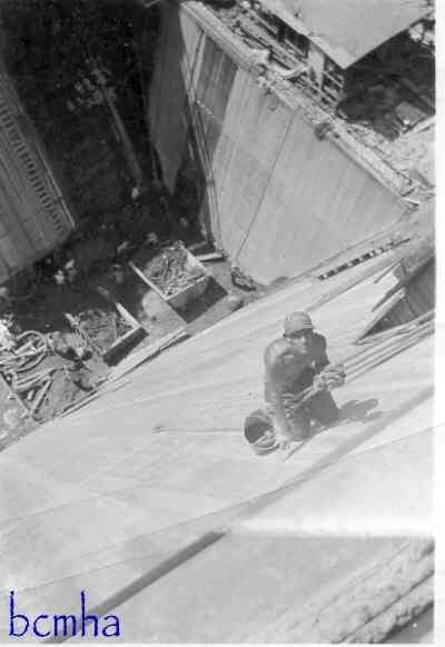 It's a long way down for this Cement Finisher on the Hoover Dam, 1934.