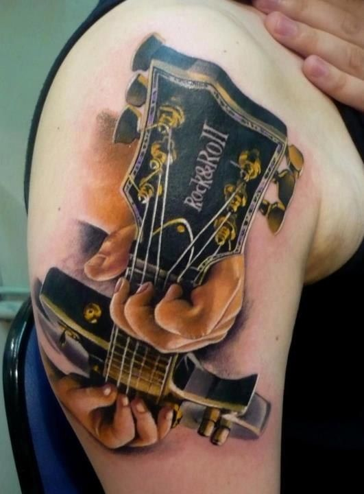 rock and roll guitar tattoo on the shoulder guitar tattoo music cool rock tattoos. Black Bedroom Furniture Sets. Home Design Ideas