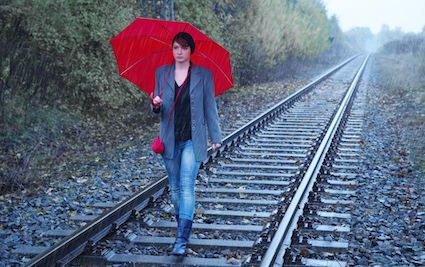 Commuters get to work quicker than usual by walking along Southern Rail tracks