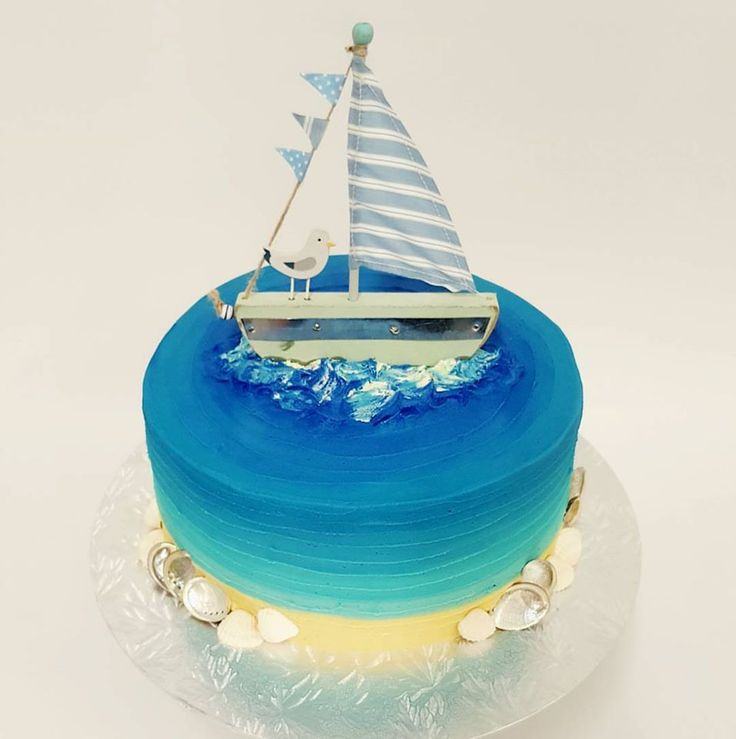 beached themed cake with Yacht