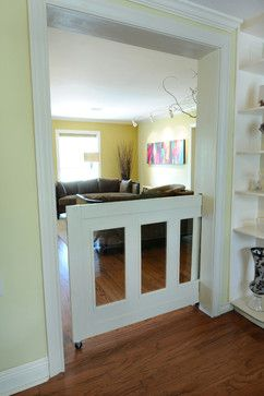 """""""A partial-height pocket door offers an elegant solution for keeping dogs or kids safe in one space."""""""