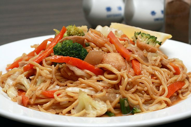 Pancit Canton - http://www.filipinofoodsrecipes.com/2010/03/pancit-canton.html    Lightly stir fried vegetables, traditionally with pork or chicken, fishballs, shrimp, sausage and tofu with steamed spaghetti-style noodles. Image by turoturo.co.nz