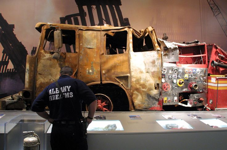 exhibit of artifacts from the World Trade Center attack which includes New York City's fire department's Engine 6, background, on Wednesday, Sept. 4, 2002, at the New York State Museum in Albany, N.Y.