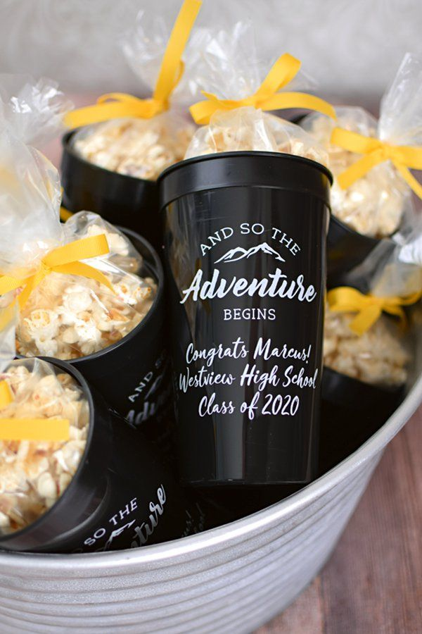 And So The Adventure Begins. These custom printed, jumbo 32 oz graduation stadium cups are the Big Gulps of party cups. Great for outdoor graduation parties and for holding popcorn, favors, and iced tea. An extra large cup for a larger than life celebration.