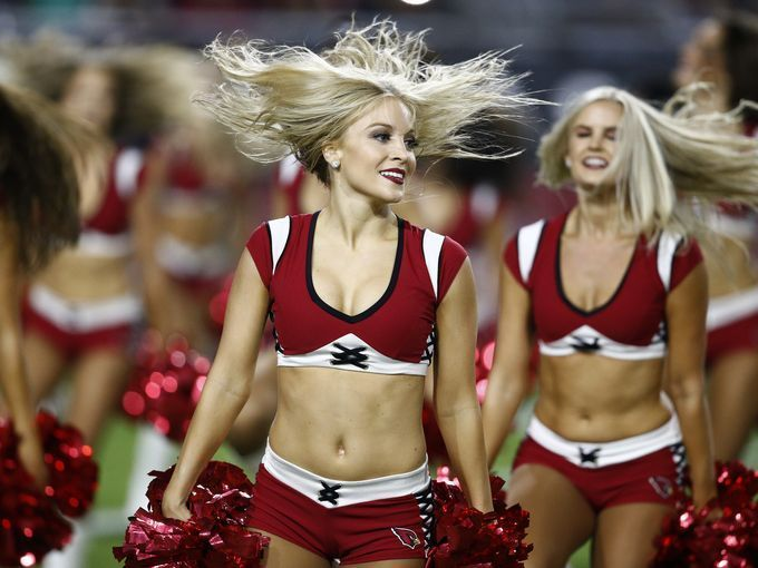 The Arizona Cardinals cheerleaders perform during the https://www.fanprint.com/licenses/arizona-cardinals?ref=5750
