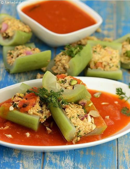 Bharwa Lauki, bottle gourd (or white pumpkin) stuffed with spicy paneer is tossed in a flavourful tomato based gravy.