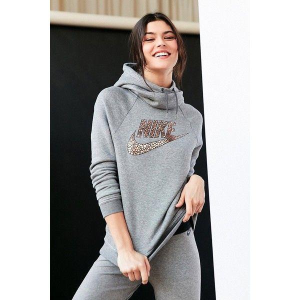 Nike Foil Rally Hoodie Sweatshirt ($65) ❤ liked on Polyvore featuring tops, hoodies, dot top, polka dot top, long sleeve tops, polka dot hoodie and hooded pullover