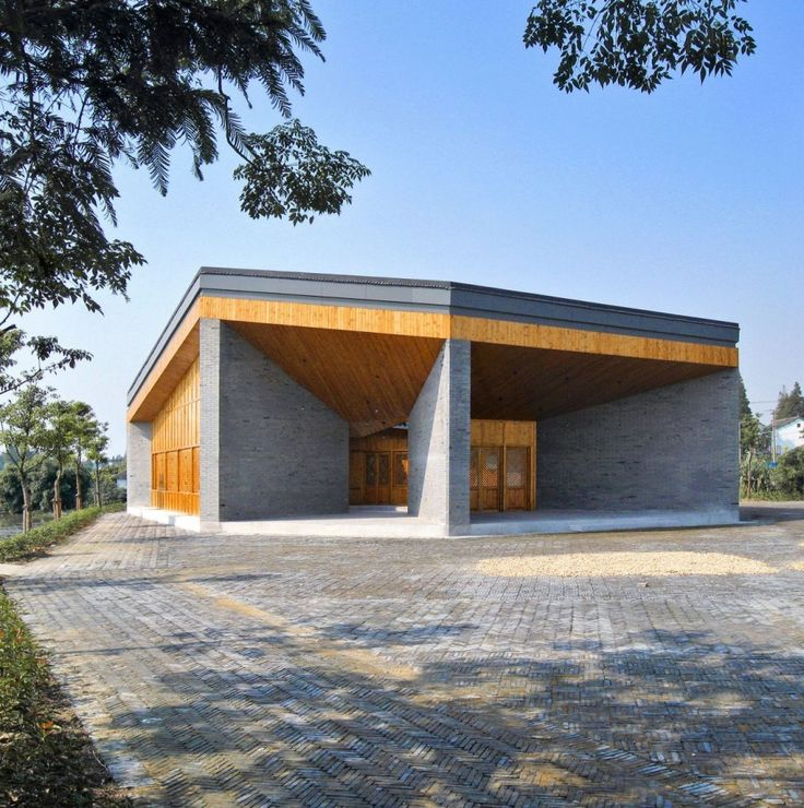 Starkness of color, awkwardly almost warm/cool keeps it high energy...Community Pavilion at Jintao Village / Scenic Architecture