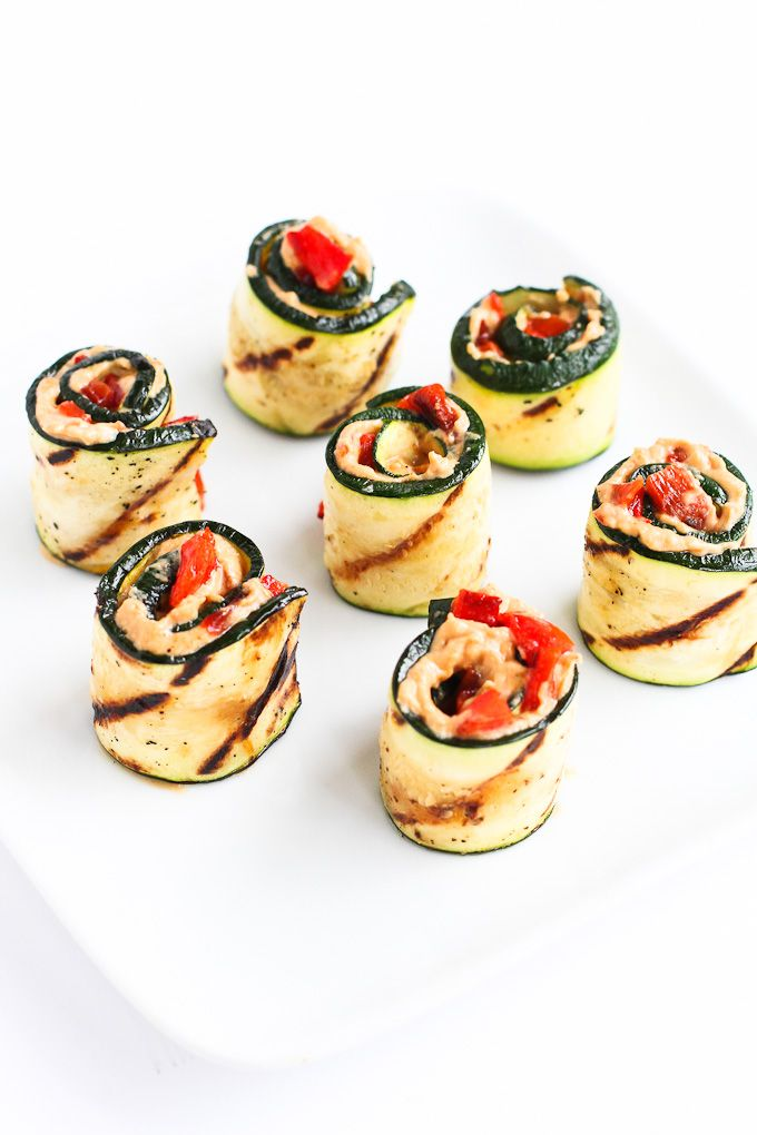 These grilled zucchini rolls are the ultimate summertime appetizers or snacks. Fill them with hummus and roasted peppers for fantastic flavor!