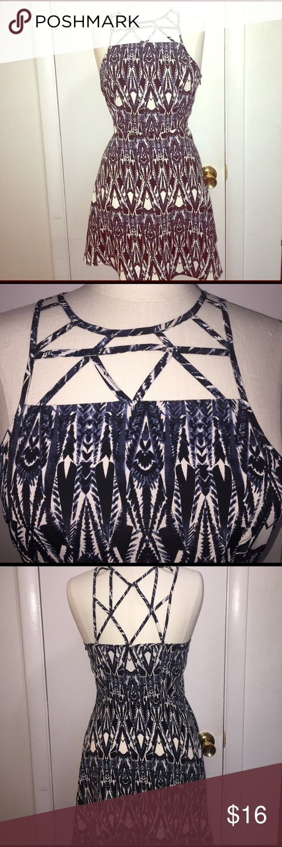 American Eagle outfitters tribal print dress Super cute American Eagle  dress with crisscross detailing in the front and back. It comes with a side zipper for easy access. American Eagle Outfitters Dresses Mini