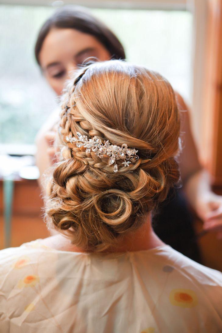 Elegant bridal updo with hair piece