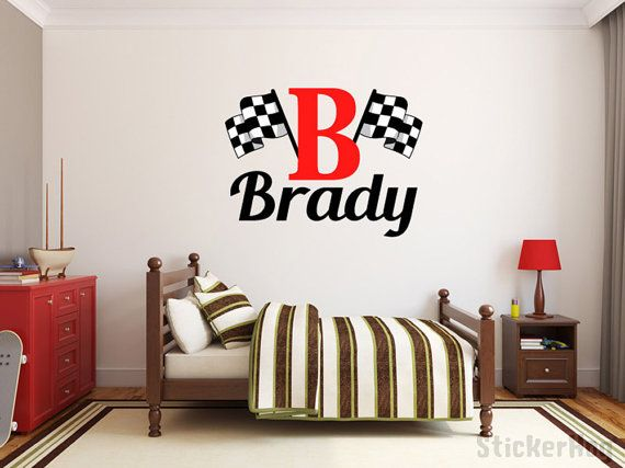 Boys Name Checkered Flag Racing Monogram Wall Decal #2 Nursery Room Vinyl Wall Graphics Bedroom Decor This personalized wall decal will add a playful touch to any nursery or boys room. This Vinyl Wall Decal comes in various sizes - (29 tall shown in product image). Size may vary depending on length of name. Custom sizes are also available at request. *Please make a note of the following when you place your order: **Name **Color for Name **Color for Initial (No color option for flags, they...