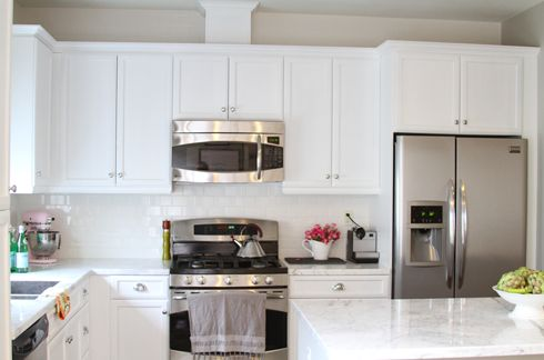 Beautiful kitchen by Made By Girl. Counters are Corian Rain Cloud.