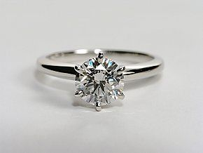 Beautifully classic, this solitaire engagement ring is crafted in platinum with a six-prong design to highlight your center diamond. #bluenile